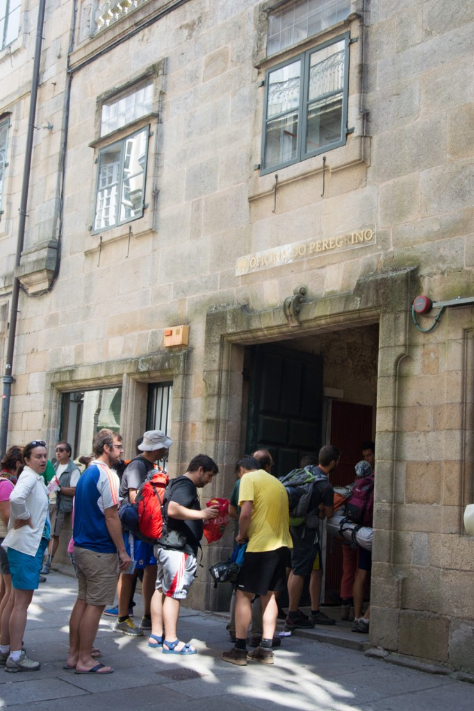 Pilgrims waiting in line at the Office of Pilgrimage